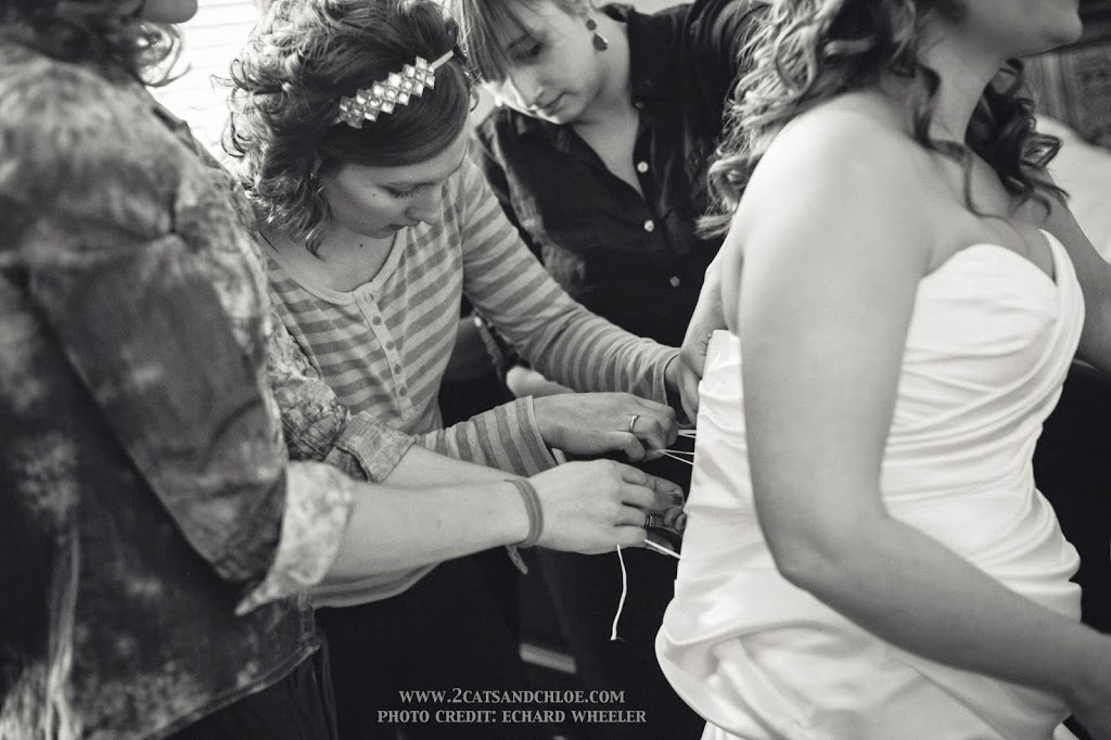 How many people does it take to tie up a wedding dress?