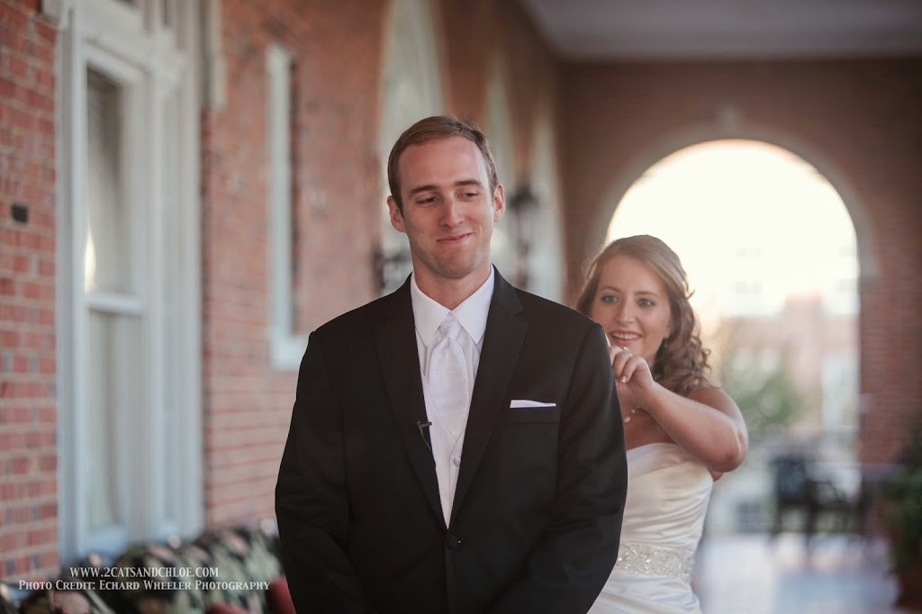 First Look - Bride taps groom on shoulder