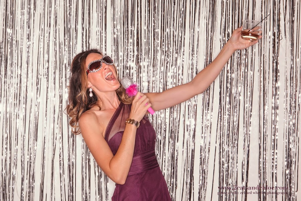 Bridesmaid singing in wedding photo booth!